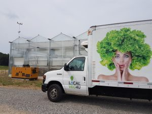 Local Vegetable Co truck and greenhouse